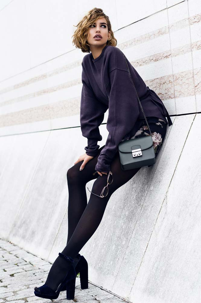 model-dunja-magazin-outdoor-fashion-lifestyle-beauty-dark-seethrough-all-black-everything-blonde-girl-beautyful-purse-accessoires-sunglass-pullover-sittin-wall